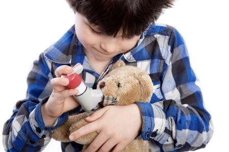 Boy with asthma pump and teddy